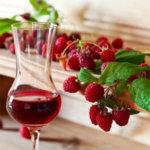 Raspberries with glass