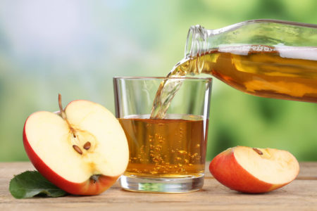 Apples with glass of apple wine