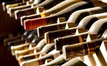Bottles Of White And Red Wine Layed Out