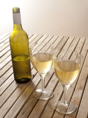 Opened White Wine And Two Glasses