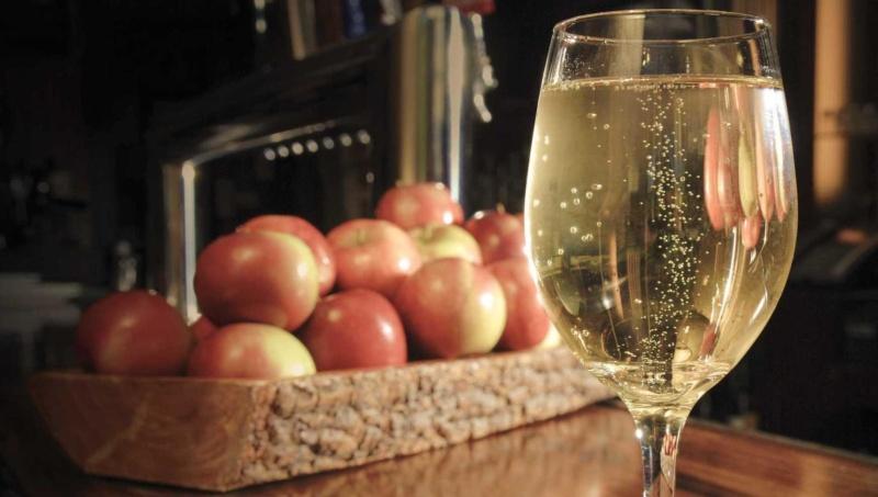 glass full of apple wine from fresh apples